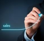 foto de homem desenhando gráfico de vendas